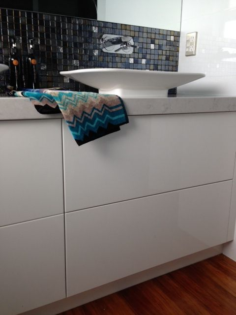 Following on from the Howick renovation the bathroom continued with the black and white pallet with the addition of a sparkly mosaic to give it a glam look #mosaics #tiles #bathroom #whitegloss #missoni #timber #interiordesign #designer