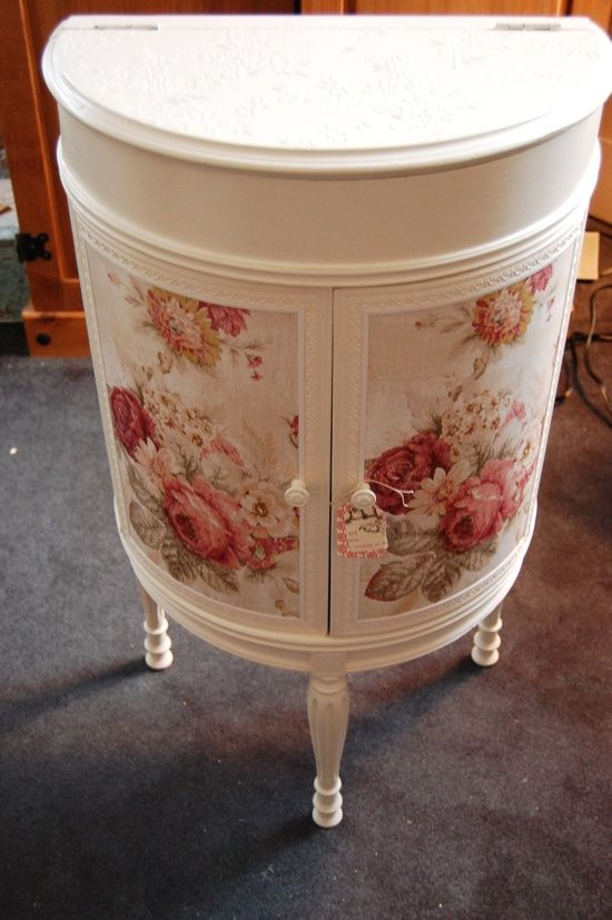 Awesome Idea!!  Fabric decoupaged furniture.   You can use Fabric Mod Podge! I might do this on the cabinet doors of my hoosier, but use fabric starch so that it is REMOVABLE!!!