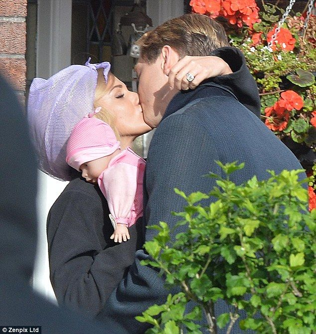 Lip service: Michelle Keegan was spotted sharing a passionate kiss with co-star Lorne MacFadyen as they shot scenes for their upcoming TV drama Tina And Bobby