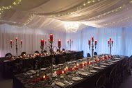 Wedding table arrangements, red wedding table candles at Tamar Valley Resort
