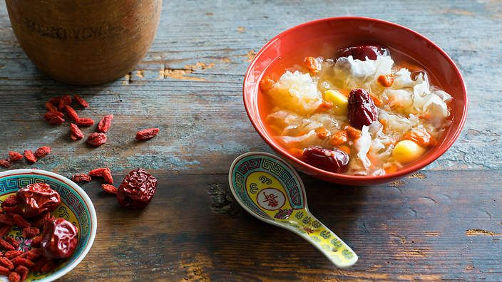 A classic Chinese breakfast, this sweet congee can be eaten warm or cold. It delivers a mix of rice, fungus and dried fruit and herbs – ingredients thought in Chinese traditional medicine to boost health and vitality. Listen to the audio recipe.