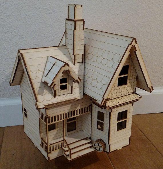Basado en la casa de Carl éxito Disney película de Pixar UP, este kit de casa de muñecas de corte láser es cortado del 1|8 abedul (inacabado). El Kit viene sin montar con instrucciones detalladas de ensamblaje en un CD. Este es un kit de madera contrachapada de abedul Báltico de alta calidad - no balsa o troquelada.  La casa mide 10.5 de ancho x 9 de profundidad x 11,5 de alto. La casa tiene 2 plantas, un porche, pasos de chimeneas, hastiales, buhardillas y frente y espalda. El techo se…