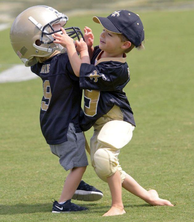 New Orleans Saints quarterback Drew Brees (9) sons Baylen, right, and Bowen play tackle during the Saints' NFL football training camp in Metairie, La., Saturday, Aug. 3, 2013 Yahoo Sports