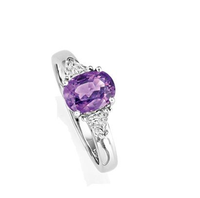 Engagement Rings - Purple Sapphire Ring  Stunning purple sapphire engagement ring in 18ct white gold set with oval cut purple sapphire of 2.03ct and round brilliant diamonds totalling 0.29ct.