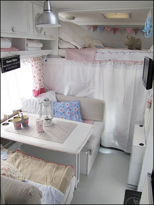 Upper bunk and curtain that hides the driver/passenger seats in this motorhome. I like the cow.