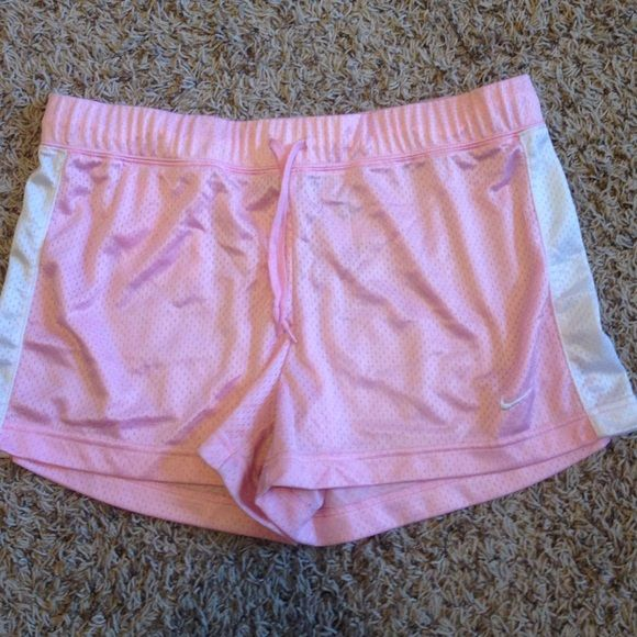 Pink Nike Basketball shorts Mesh Nike basketball shorts. In really good condition but too big for me. Nike Shorts