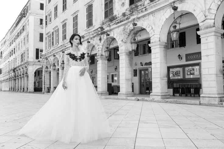 white wedding dress ,black detail by Marianna Kastrinos.