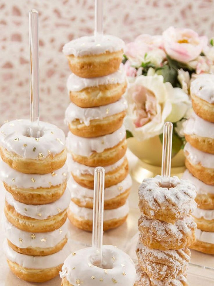 Opt for stacked doughnuts over a wall display for a low-maintenance dessert decoration display at a bridal shower or bachelorette party.