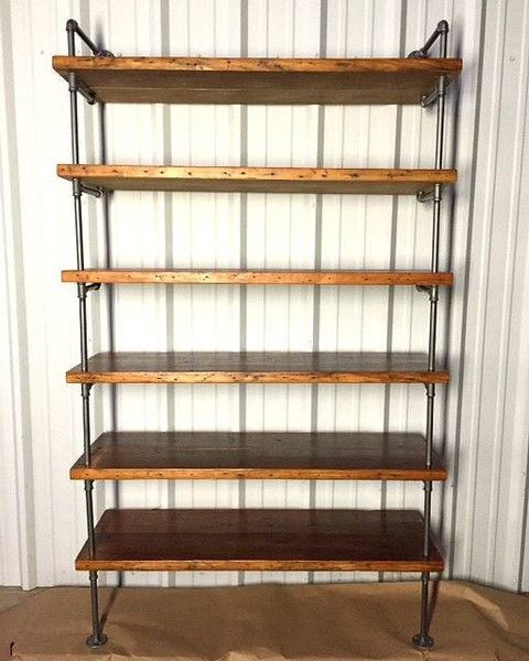 This hanging suspended chain bookshelves are made from all reclaimed materials. Shelf height is fully adjustable. This is an original Industrial Envy concept that started as a hand sketch. This listin