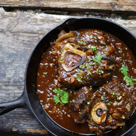 Simple osso bucco recipe. Slow cooked beef or veal shanks, braised to absolute fall-off-the-bone tenderness.