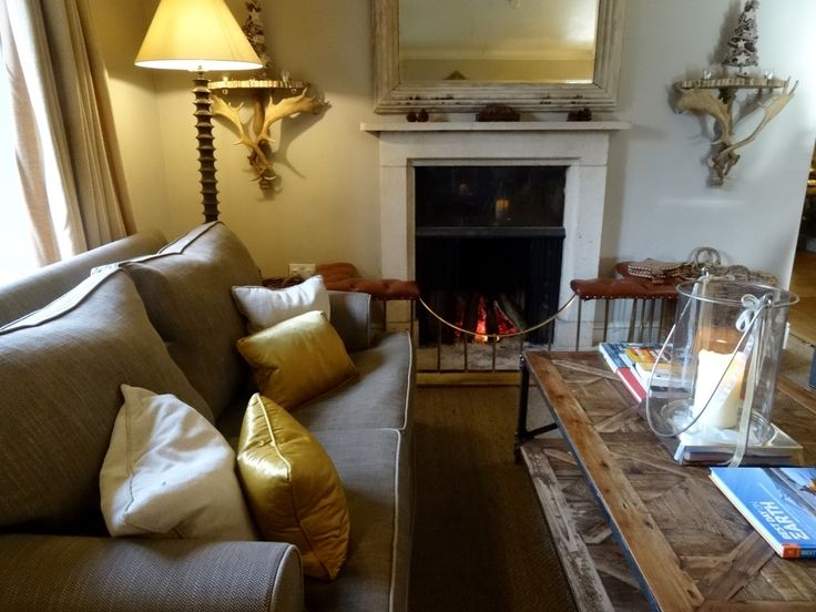 Relaxation zone in the lounges of Calcot Manor. Rest your bones and warm your feet at our open fire. For even more comfort, add a glass of wine and exhale... http://www.calcotmanor.co.uk