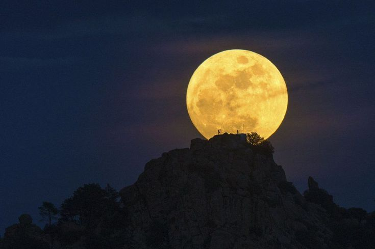 Dani Caxete took Man on the Moon, using a telescope as his friend posed on Pena Munana, in Cadalso de los Vidrios, Spain.