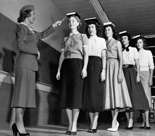 Miss Lepper instructs her female students in walking with poise