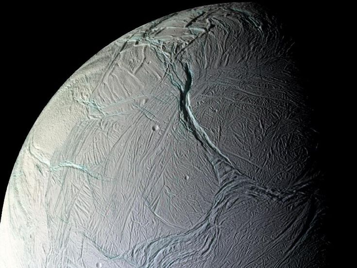 On Oct. 5, 2008, just after coming within about 15 miles of the surface of Enceladus, NASA's Cassini captured this stunning mosaic as the spacecraft sped away from this geologically active moon of Saturn.: Icy Moon, Saturn Moon, True Colors, Icy Enceladus, De Saturn, Blog, Astronomy, Crusts, Outer Spaces