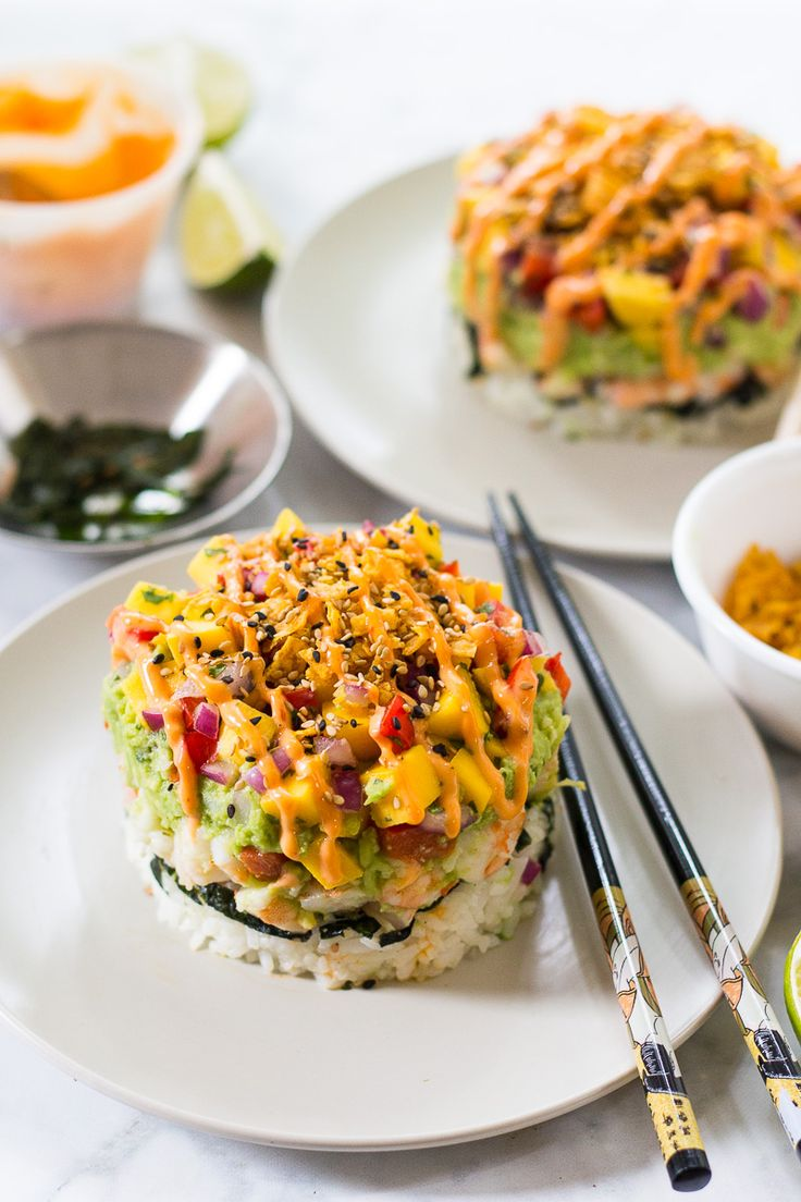 Spicy Shrimp Stacks with Mango Salsa are a fun twist on a spicy California roll, topped with guacamole and Bang Bang sauce!