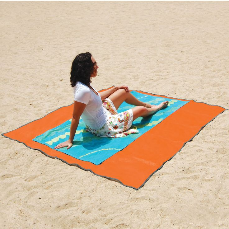 The Sandless Beach Mat - Hammacher Schlemmer Sand filters out from top and doesn't reenter from the bottom.