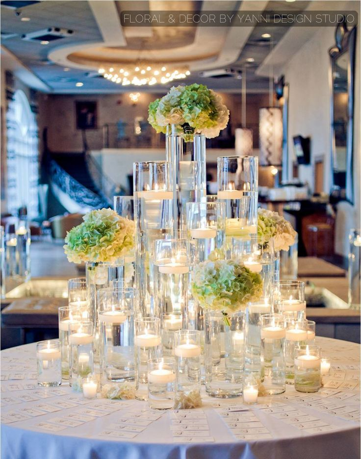 Wedding Decor Features A Beautiful Floating Candle Display With Colored