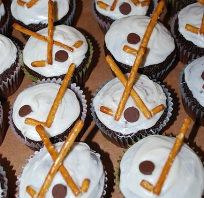 Hockey Cupcakes - top with pretzel sticks and chocolate chips.  Turn the chip point into the frosting.