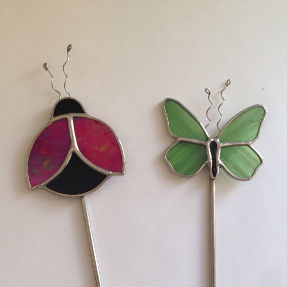 Stained glass butterfly and lady bug plant sticks glass