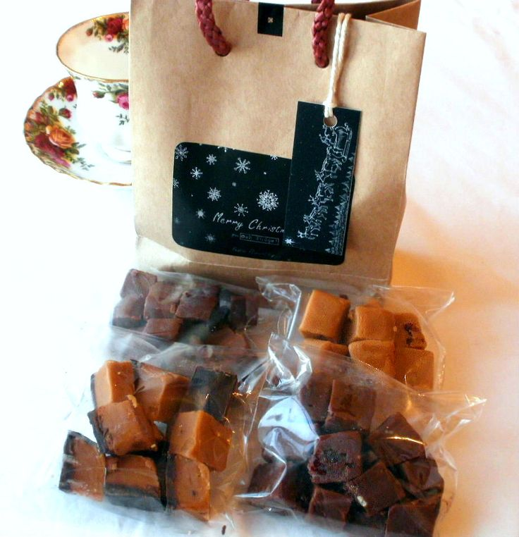 Chocolate Box: Festive Flavour option. 4 75g bags in Gift bag with unique designed tags. Black Forest Gateau (Dark choc fudge with white choc chunks and morello Cherries soaked in Kirsch); Chocolate topped Sea-salted Caramel; Chocolate Orange; White Chocolate and Cranberry. Only natural flavours and ingredients go into making truly indulgent all butter, clotted cream fudge!