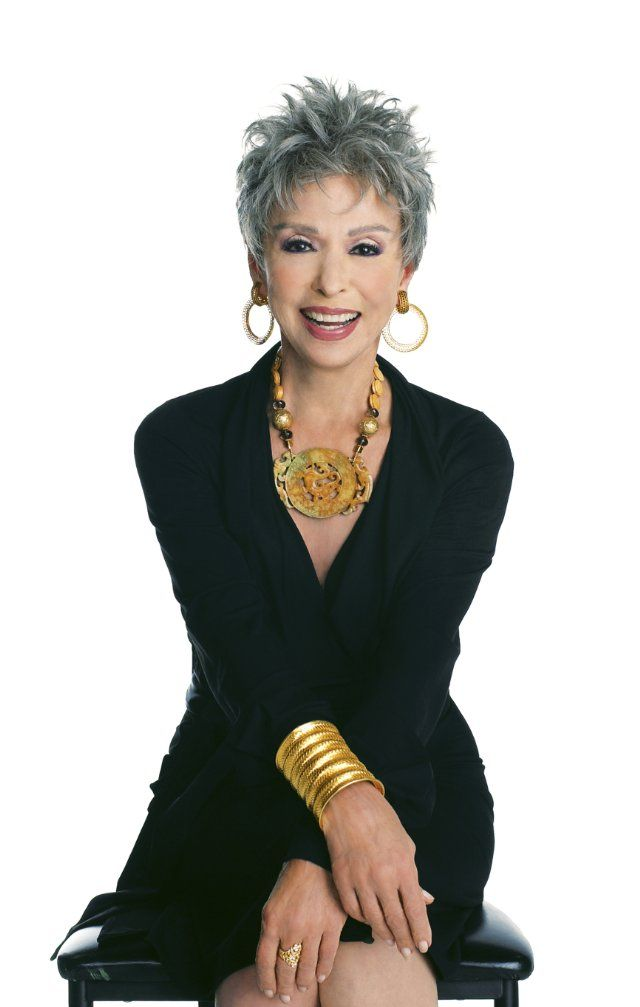 Wow! Rita Moreno -- ageless! Elegant women of a certain age don`t need to be outlandish or showy to be elegant;  a good, v-neck black dress and good accessories are what it takes: chunky necklace, hoop earrings, shiny cuff, and some make up.