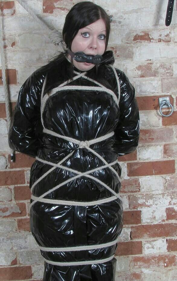 Bondage in plastic rainwear  FLAPPY