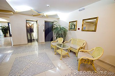 A hotel lobby with elevator doors, one open with a blurred person inside it.  <a href='http://www.dreamstime.com/interiors-rcollection4789-resi208938' STYLE='font-size:13px; text-decoration: blink; color:#FF0000'><b>MY INTERIORS COLLECTION »</b></a>
