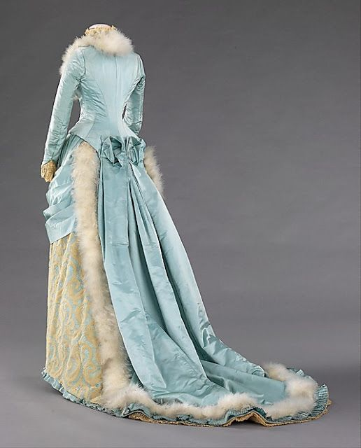 18th century fashion | Evening dress by R.H. White & Company (1885) made of silk and feathers