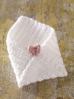 """Featuring a little heart, this little """"envelope"""" is a great way to hold your forks, knives, and spoons for that special Mother's Day or Valentine's Day meal. (Lion Brand Yarn)"""
