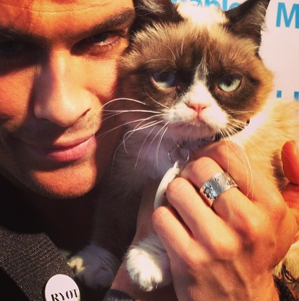 Ian Somerhalder: He can make even Grumpy Cat smile.  No, seriously. It looks like she's smiling a little.