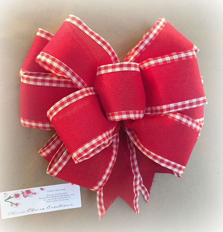 Hand Tied Christmas Bow made with a red wired ribbon with