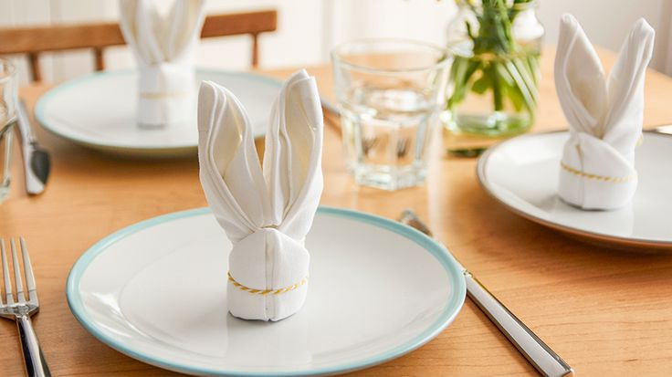 Easter Inspiration, available from Whitefriars, Canterbury.    Tesco,Easter table setting with folded bunny napkin on a plate