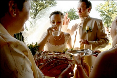 Polish Wedding Tradition: The  bride picks first which one of the two glasses she wants to drink out of. (Of course it is impossible to tell which one has vodka and which one has water). Whichever one of the two gets vodka, it symbolizes that this will be the dominant person in their marriage.