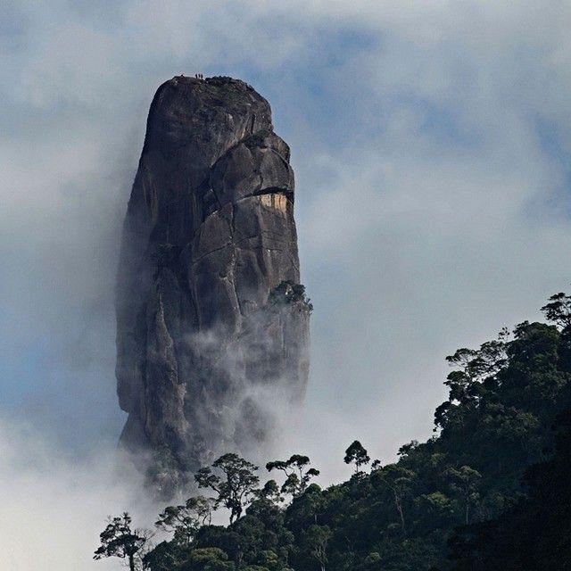 Climbers are seen on top of the 1692 metre high 'Dedo de Deus' (Finger of God) mountain located in the Serra dos Orgaos National Park, Rio de Janeiro state, Brazil. Credit: AFP