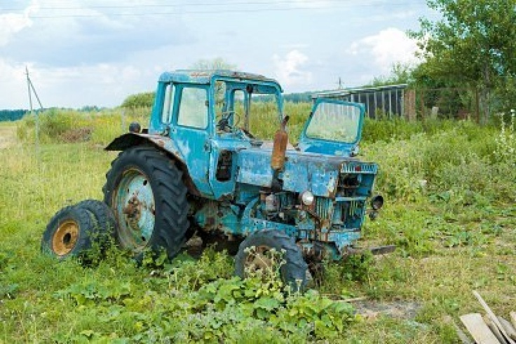 Broken Tractor Ford : Old abandoned tractor rusty and broken one three