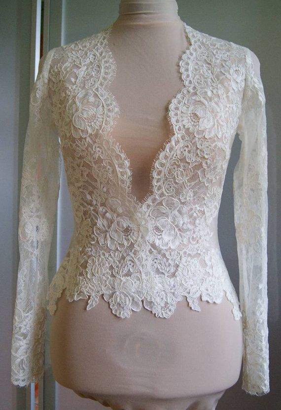 Unique beautiful wedding jacket-bolero. color : 1. ivory 2. white Bolero made with lace. Lace is hand-cut .Fastened at the front Bolero length below the