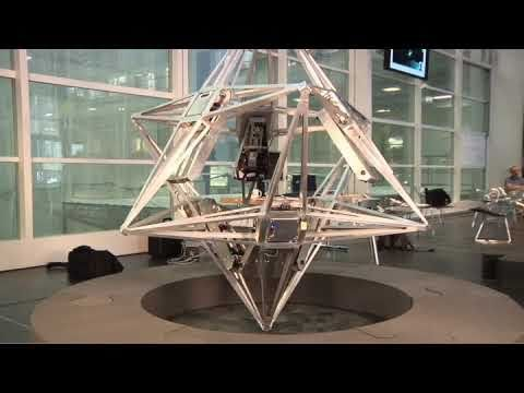 The Balancing Cube can balance on any of its edges or corners. It owes this ability to six mechanisms on each inner face that rotate in concert and achieve equilibrium for the overall system. Each of the mechanisms is an autonomous unit with sensors, a computer, a motor, and a battery on board. The six mechanism share information and coordinate themselves over a network of their computers.