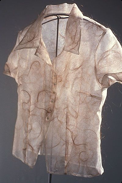 "Victoria May used to make custom wedding gowns, also created this series of blouses.  The idea for this series came from May's past experience in creating custom tailored gowns. She specialized in following the contours of each individual's body, no matter how ""imperfect."" Every imperfection of the client was revealed by precise measurements and accommodated for. These blouses, rather than hide imperfections, reveal ones that only exist in the mind and are never visible."