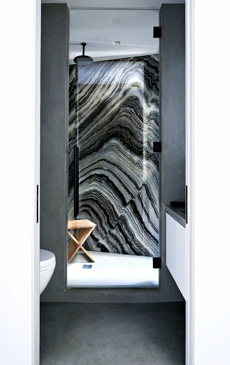 This mercury black #marble #slab is just stunning as the focal point in this shower stall. The grey, black and white combination gives this #smallbathroom a sleek and #contemporary look