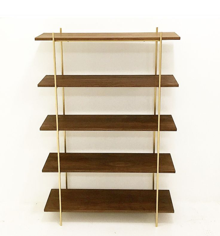 "Walnut and Gold metal wall unit. Includes 5 walnut shelves Dimensions: 40""W X 13""D X 60""H White Glove shipping available through out the Continental US. Curbside delivery available in Los Angeles and"