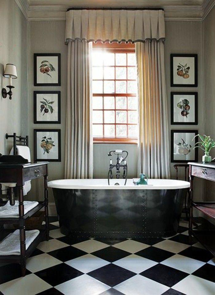 une baignoire fonte ancienne de couleur noir et les baignoires anciennes