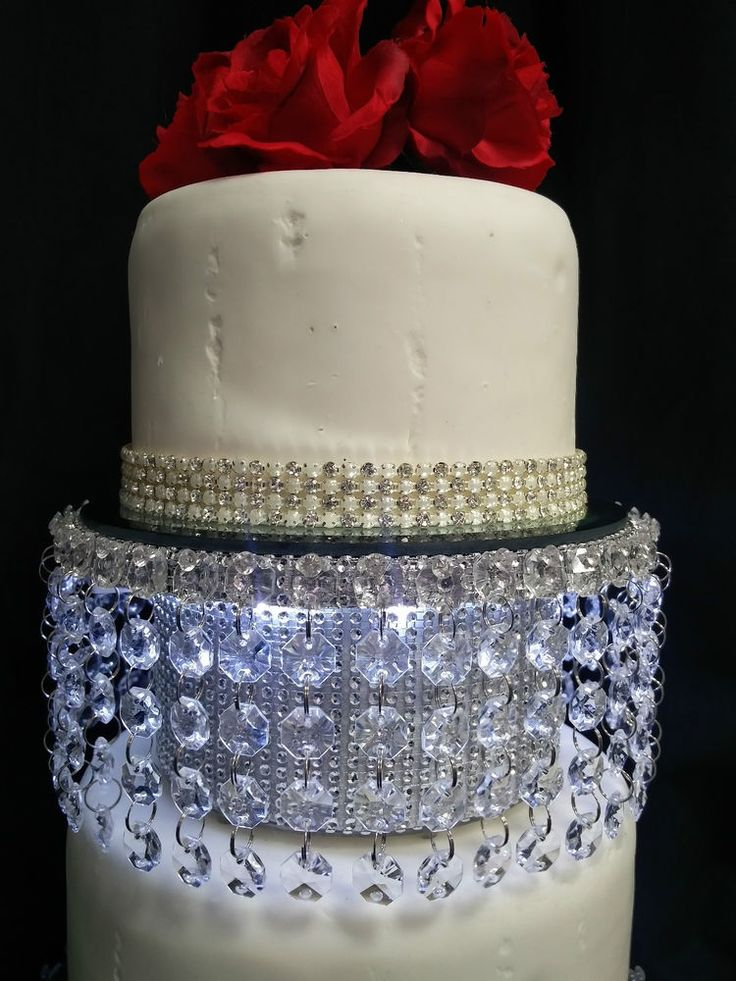 """Made from either Acrylic crystal effect finish beads gold or silver or real clear Swarovski / Austrian glass crystals gold or silver- choose above. The cake separator is 3.5"""" high in round or square shape.   eBay!"""