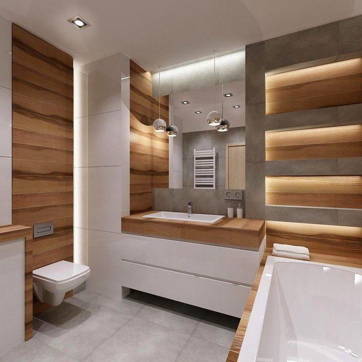 salle de bain blanche aux accents de bois, avec une déco murale aspect béton et des niches de rangement lumineuses