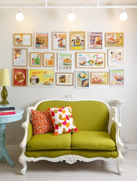love this sofa, love the framed mag cover ideas - it would work great with posters too.  Love the  cushion colours.  So unusual.
