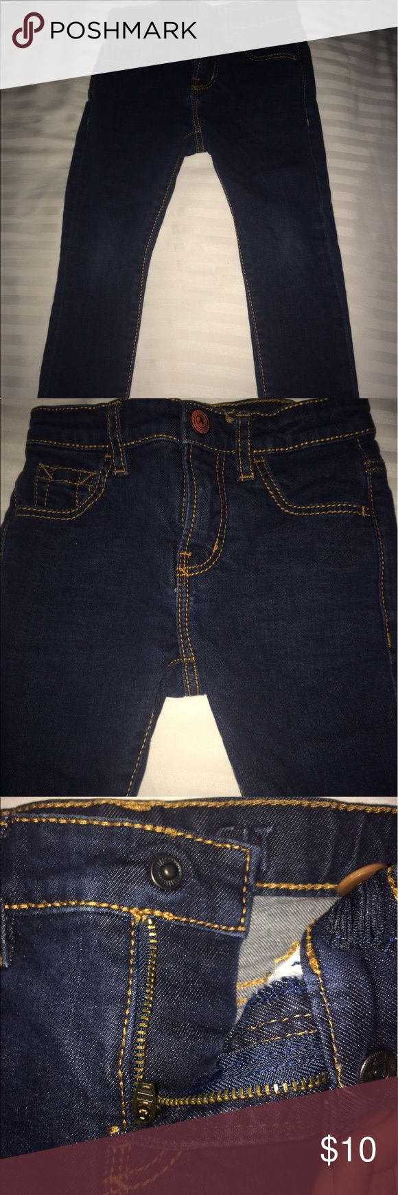 Zara Kids Dark Blue Denim Jeans Great Condition dark blue denim jeans from Zara. It has orange stitching on back pockets. It also has hidden snap fly and adjustable inner elastic waist. Slight discoloration on the knees Zara Bottoms Jeans