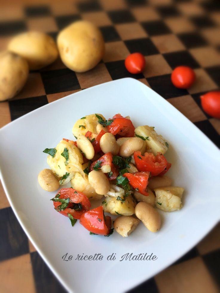 Insalata di patate con pomodori e fagioli