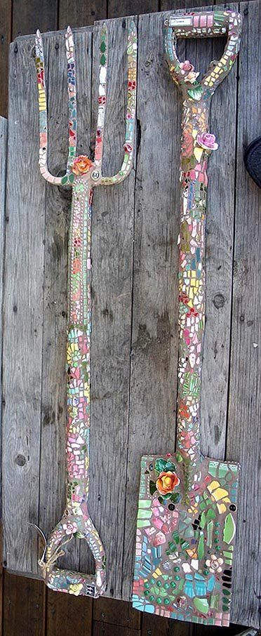 Old garden tools repurposed into pique assiette garden mosaic wall hangings