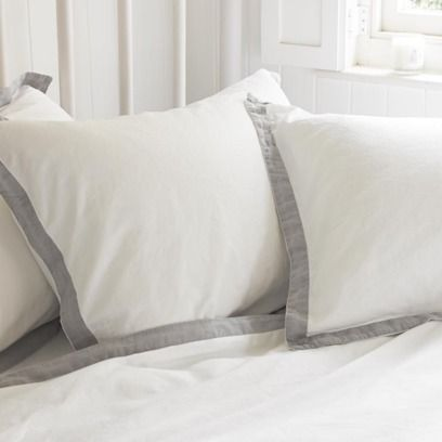 CRUMPLE. This is where two lovely things meet to create one big ball of… well…er… loveliness. The super-soft 300 thread count cotton has a light grey linen border applied by hand before being washed to give it a gentle feel.