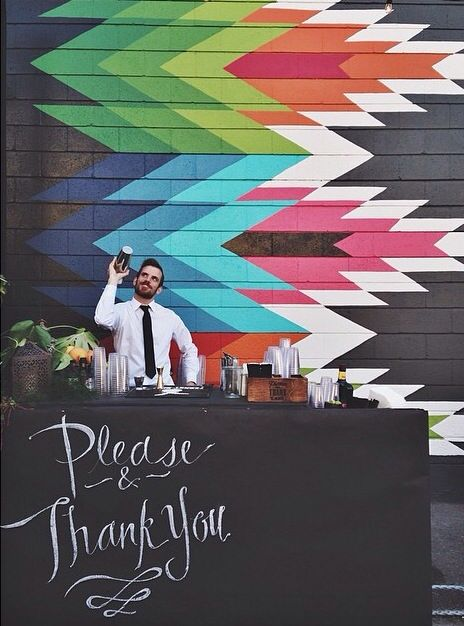 Awesome wall and the perfect simple bar set up for an event