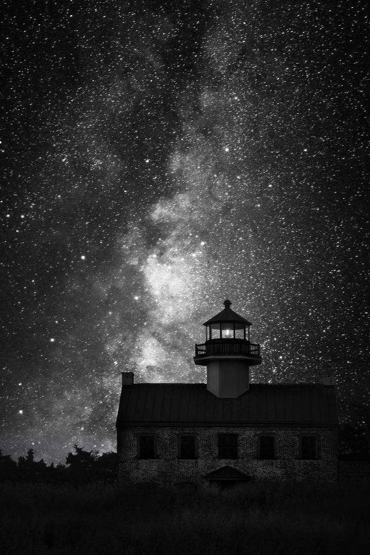 UNDER THE RAIN OF STARS II by Nenad Spasojevic - ...shot of the east Point Lighthouse, NJ...